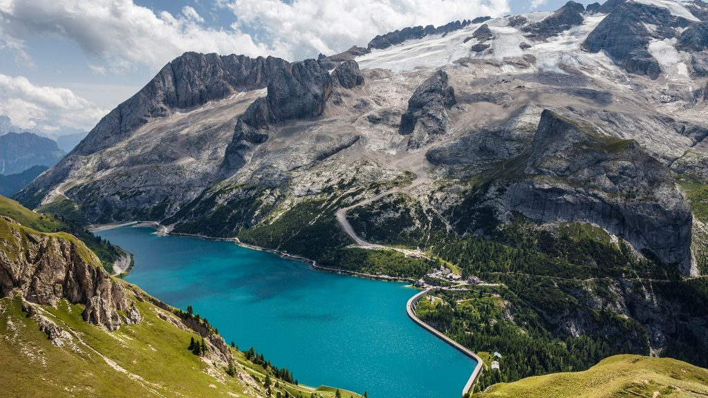 Fedaia Pass with lake at the foot of Marmolada, Dolomites, Italy