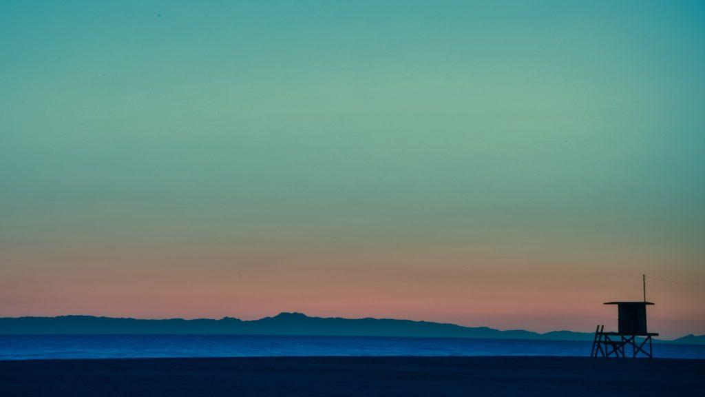 Lifeguard sunsets, Venice Beach, California, USA