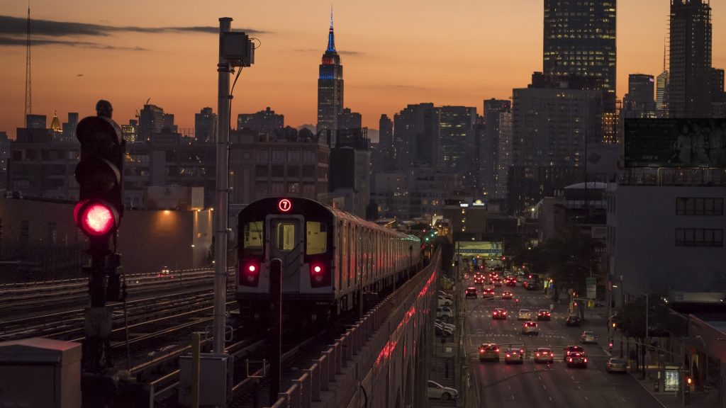 Train #7 with Manhattan and the Empire State building, New York City, USA