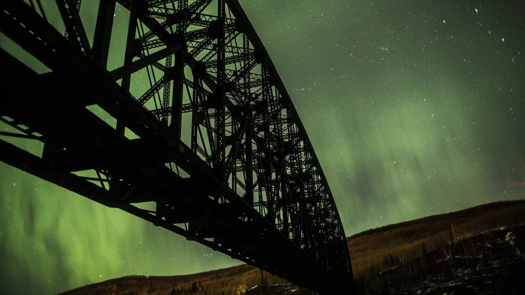 Mears Memorial bridge and Northern lights, Alaska, USA
