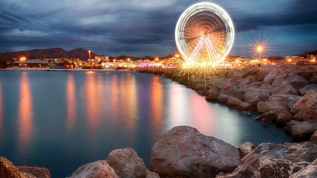 Ferris wheel in Old Port, summer evening in Marseille, France