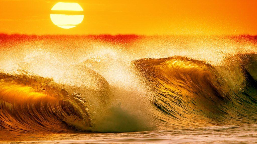 Ocean waves on a beach at sunset in Piriápolis, Maldonado, Uruguay