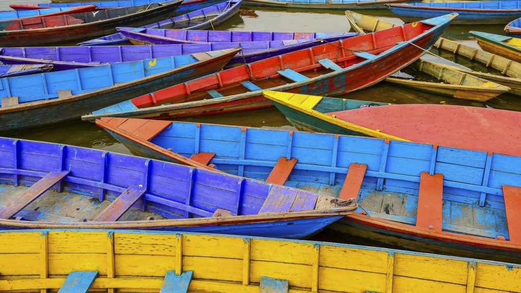 Old colorful sail boats in the lake, Pokhara, Nepal