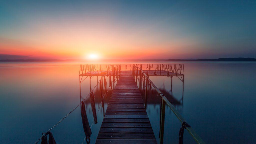 Sunset over water, pier at Balaton lake, Hungary