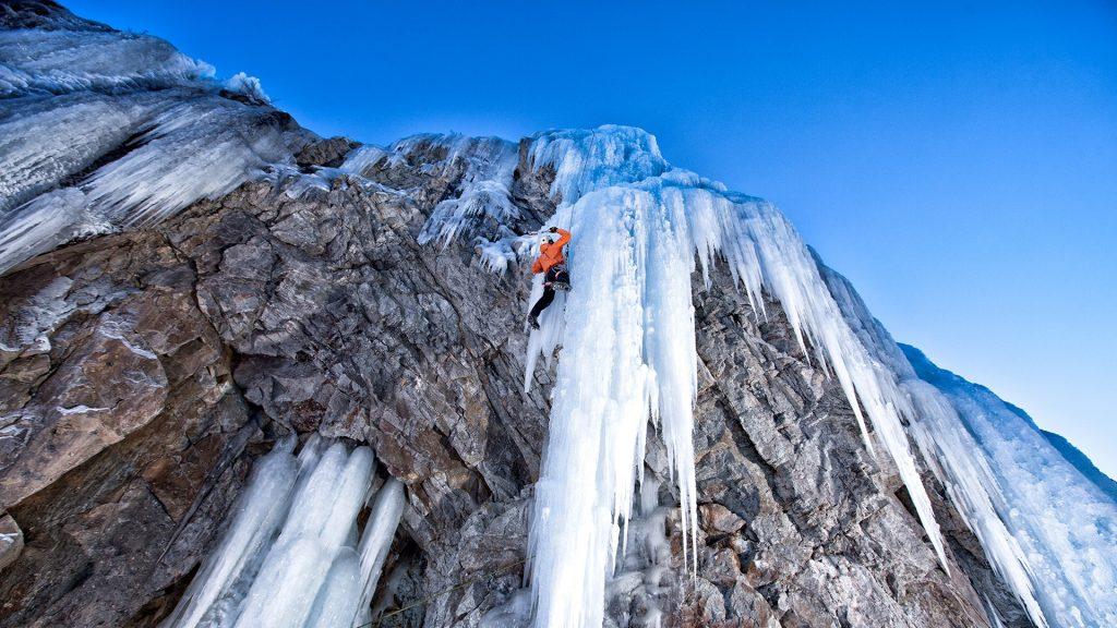 Man climbing frozen waterfall, Lake City, Colorado, USA
