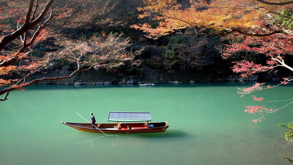 Rowing boat on Katsura river, Arashiyama, Japan