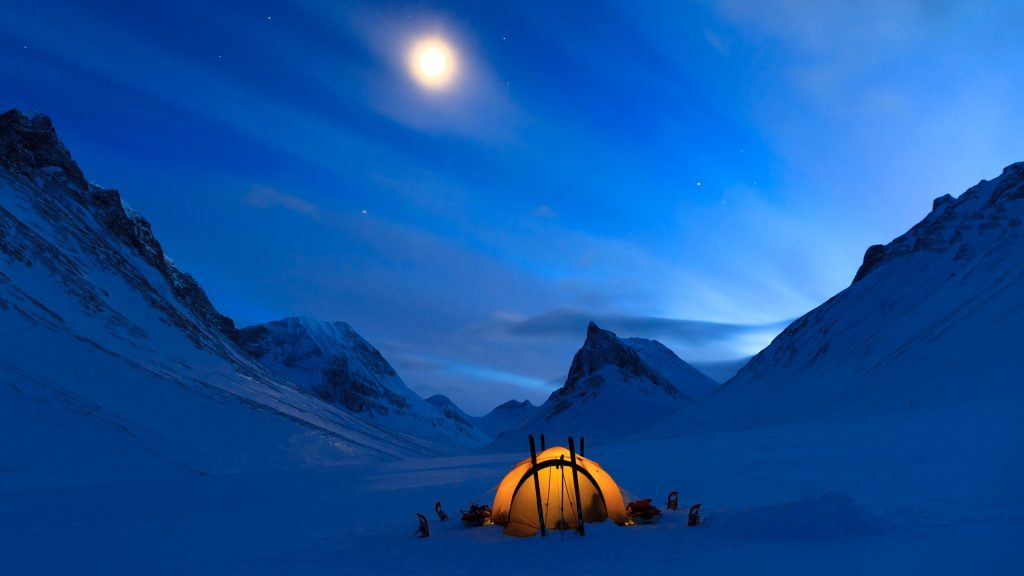 Tent under the night sky in snow covered Lapland near Nallo, Sweden