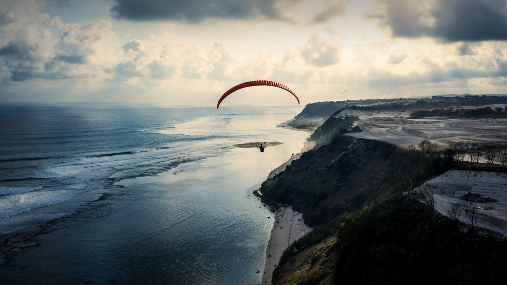 Swing paraglider at sunset in Timbis, Bali, Indonesia