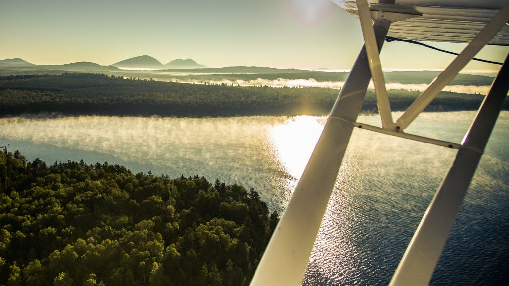 View from flying biplane, Moosehead Lake, Maine, USA