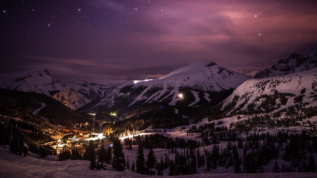 Nighttime illumination above Sunshine Ski Village, Banff, Alberta, Canada