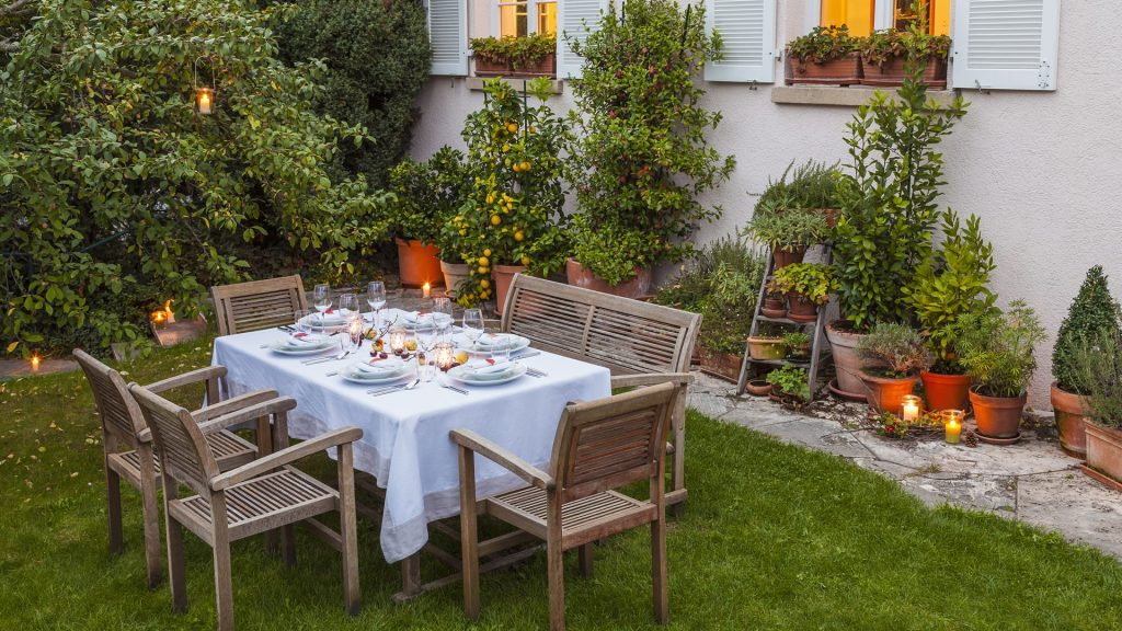 Autumnal laid table in garden in the evening, Baden-Württemberg, Germany