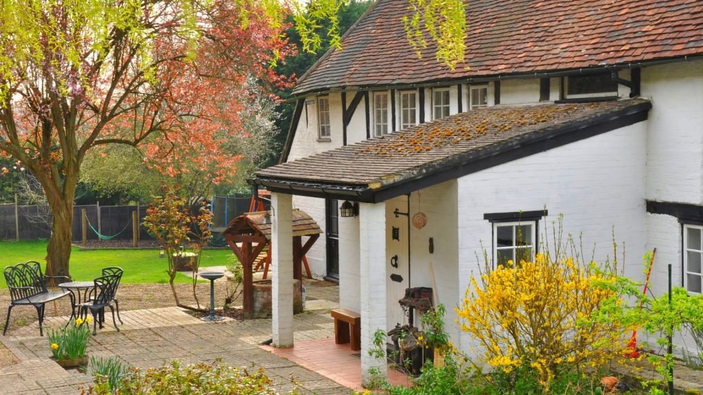 Exterior of house, white british cottage