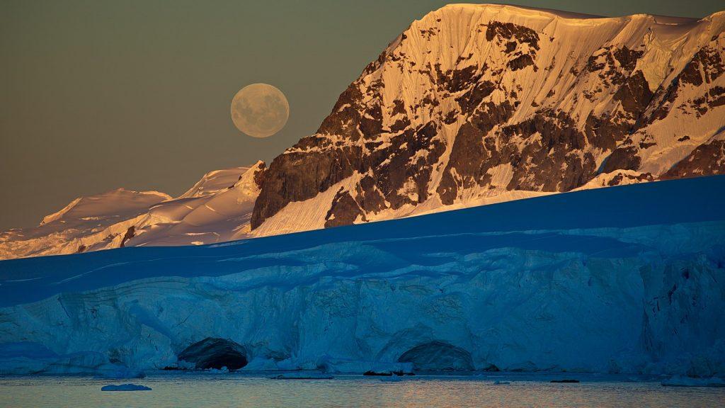 Full moon rising over Wilhelmina Bay in Antarctica