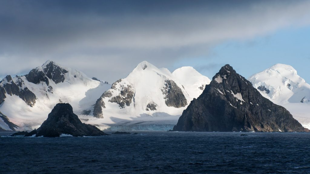 Landscape of conical mountain peaks on King George Island, Antarctica