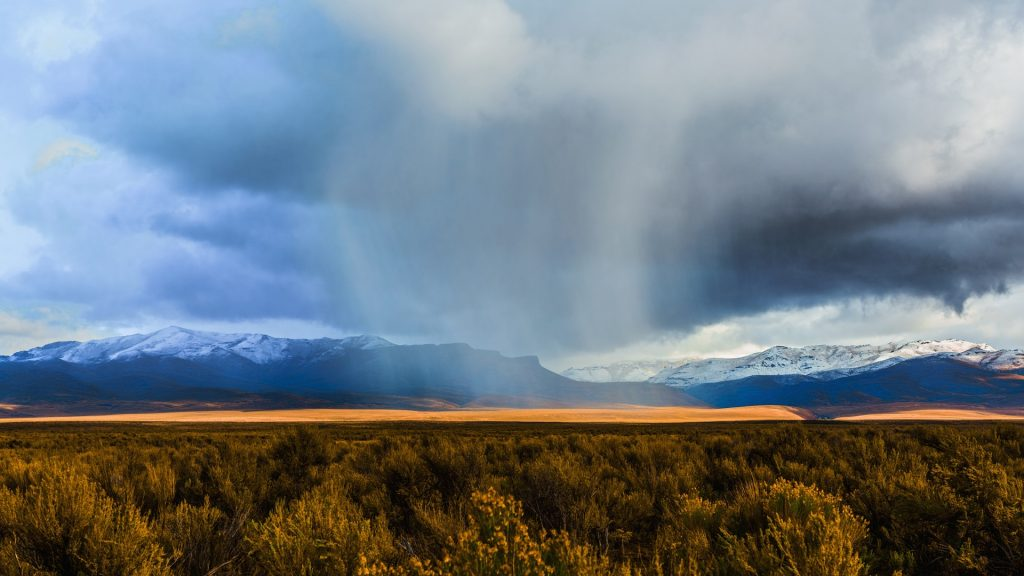 Storm clouds moving across rural prairie, Orovada, Nevada ...