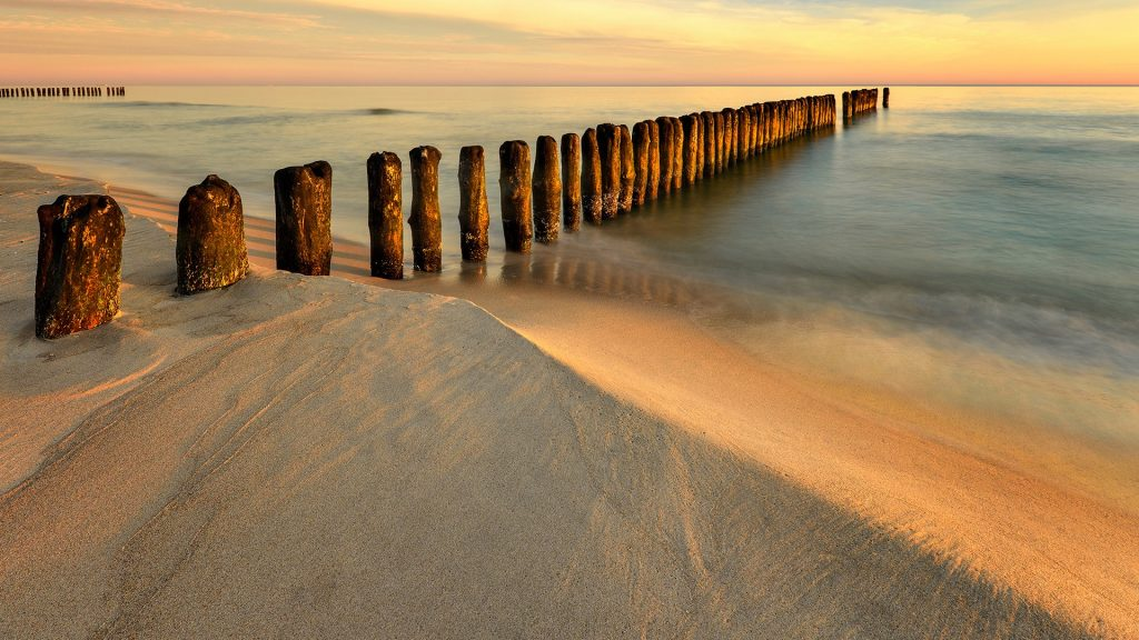 Sandy beach at dawn, Leba, Baltic Sea, Poland