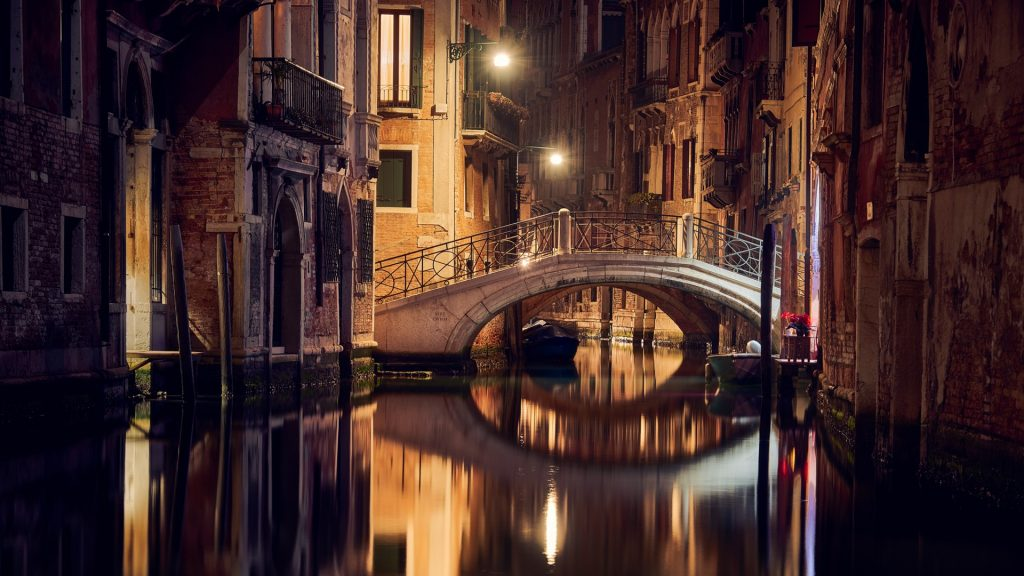 Illuminated footbridge at night, Venice, Italy