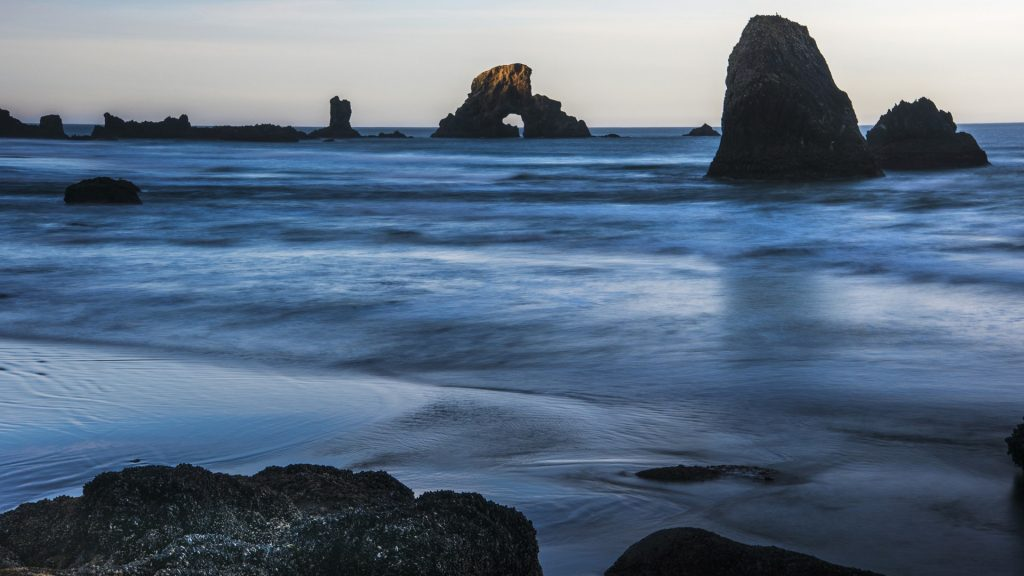 The sun comes up on sea stacks, Cannon Beach, Ecola State Park, Oregon, USA
