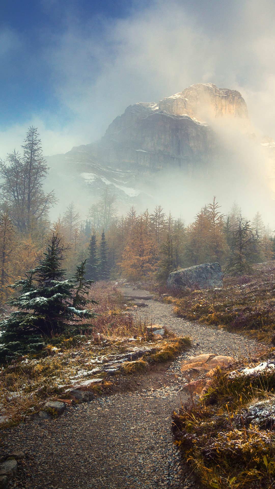 trail with mountain in mist  banff national park  alberta