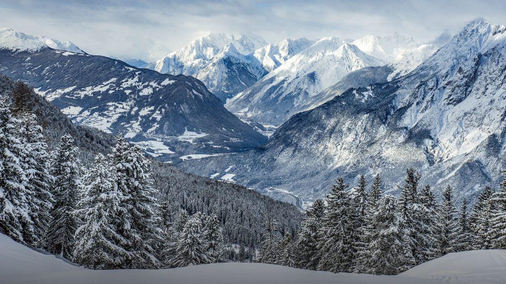 Snowy mountain peaks of Tyrolean Alps in distance