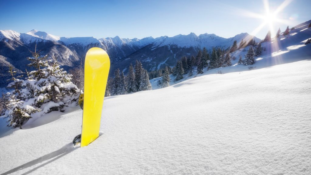 Powder snow and snowboard on a sunny day in the Alps, Bad Gastein, Austria