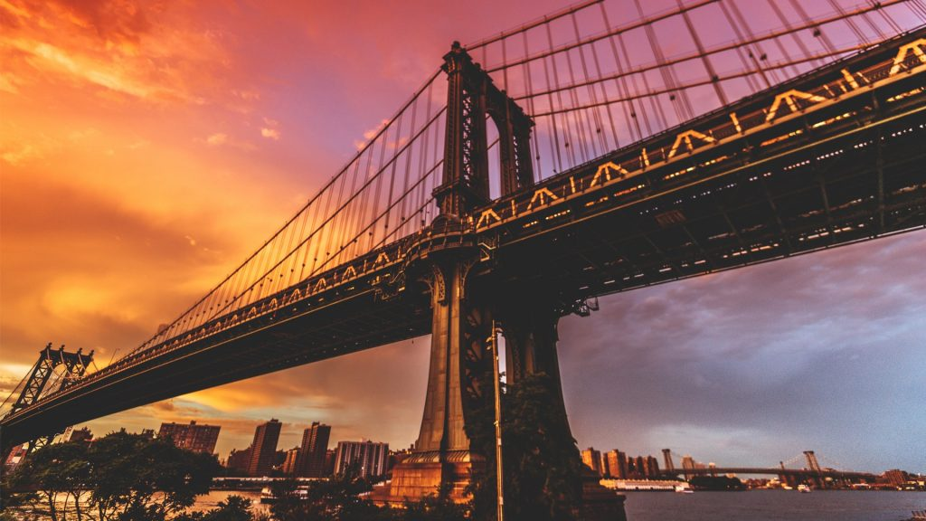 Manhattan Bridge in New York City at dawn retro style, USA