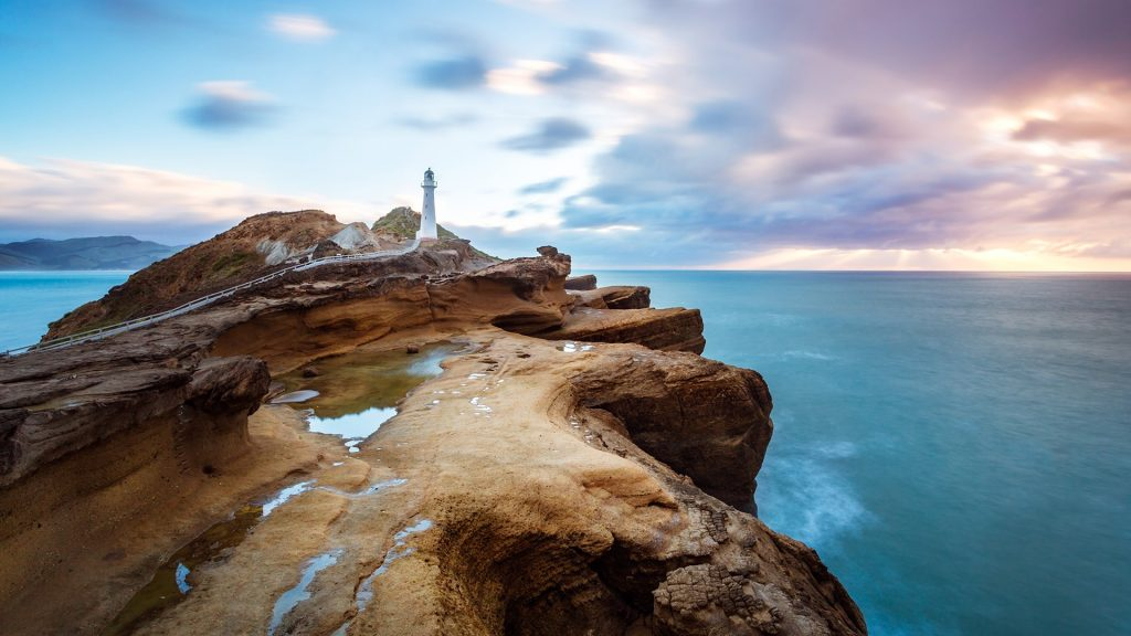 Castlepoint lighthouse at sunrise, Wellington region, Wairarapa, North Island, New Zealand