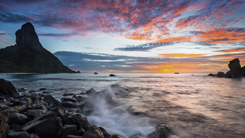 View of sunset at Praia da Conceição beach with Morro do Pico, Fernando De Noronha, Brazil