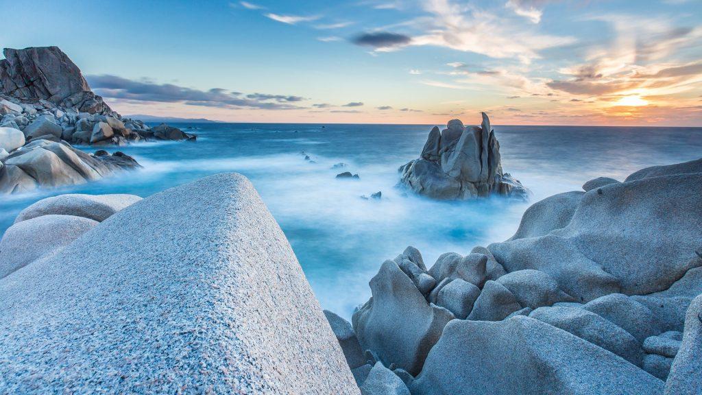 Waves on rocks of Capo Testa Peninsula, Santa Teresa di Gallura, Sardinia, Italy
