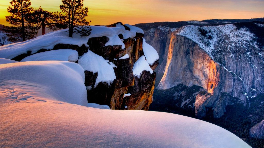 Winter sunset on Horse Tail Falls from Taft Point, Yosemite National Park, California, USA