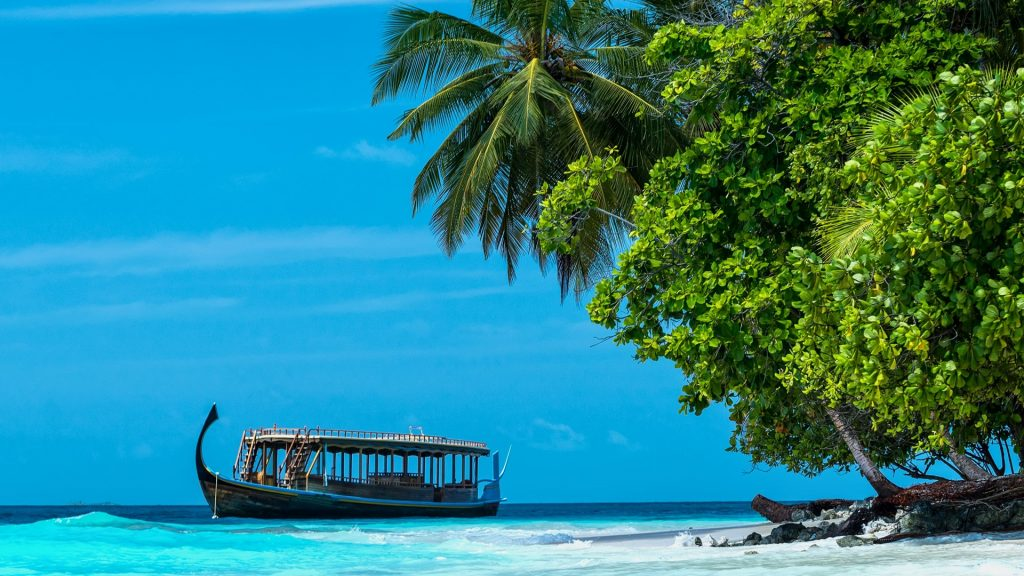 Tropical island beach and boat, Dhigurah, Maldives