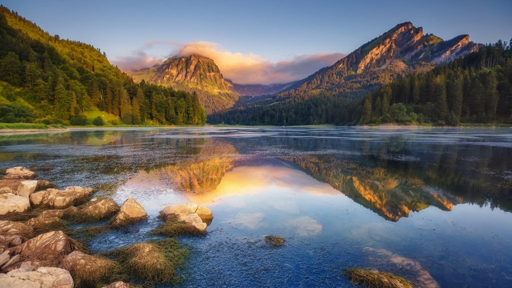 Lake Obersee under sunlight, Näfels, Mount Brunnelistock, Swiss Alps, Switzerland