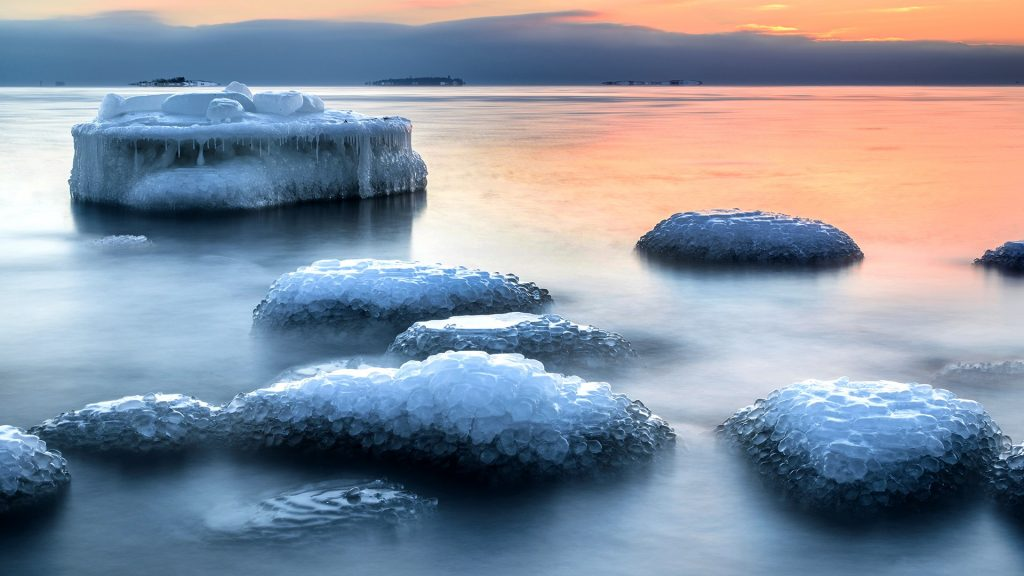 Ice covered sea rocks in evening, Helsinki, Finland