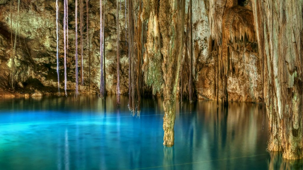 Clear blue water of Xkenken cenote in Dzitnup, Mexico