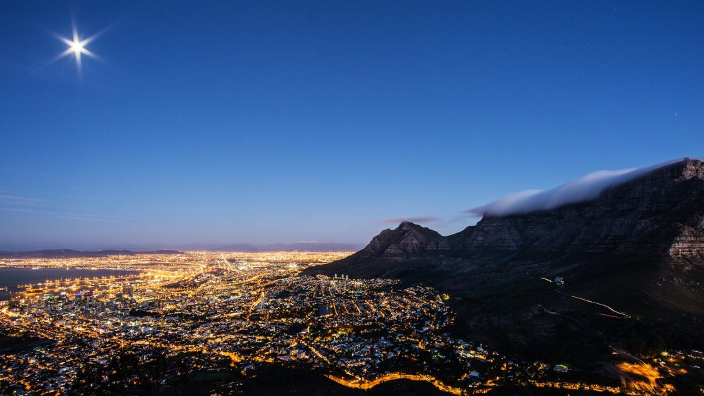Aerial view over illuminated Cape Town cityscape at the foot of Table Mountain, South Africa