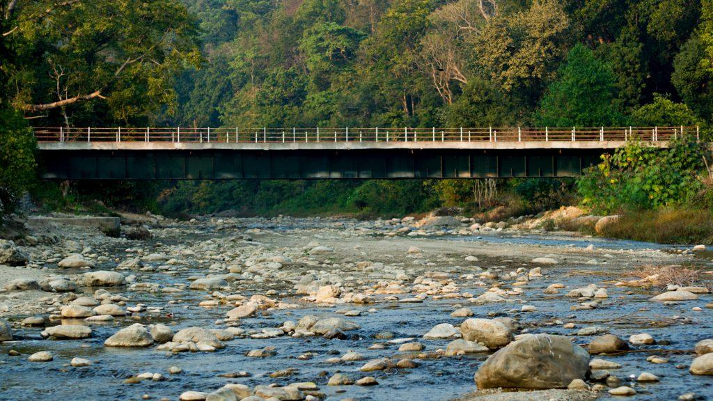 Bridge passing over a mountain river, Jim Corbett national park, Nainital, Uttarakhand, India