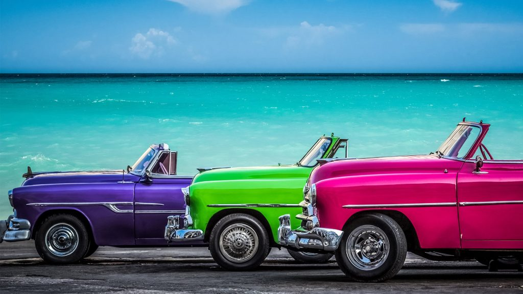 Chevrolet Cabriolet classic cars before the Caribbean Sea on the Malecón, Havana, Cuba