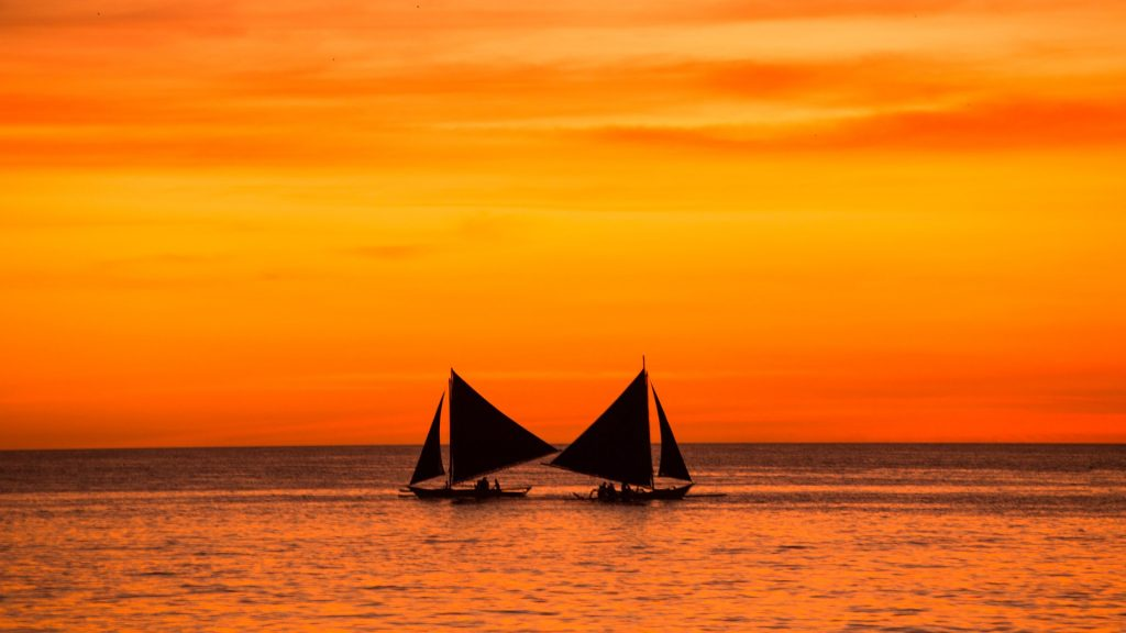 Sailing boats at sunset, Boracay, Philippines