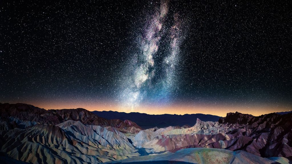 Milky Way over Zabriskie Point with Panamint Range in distance, Mojave Desert, California, USA