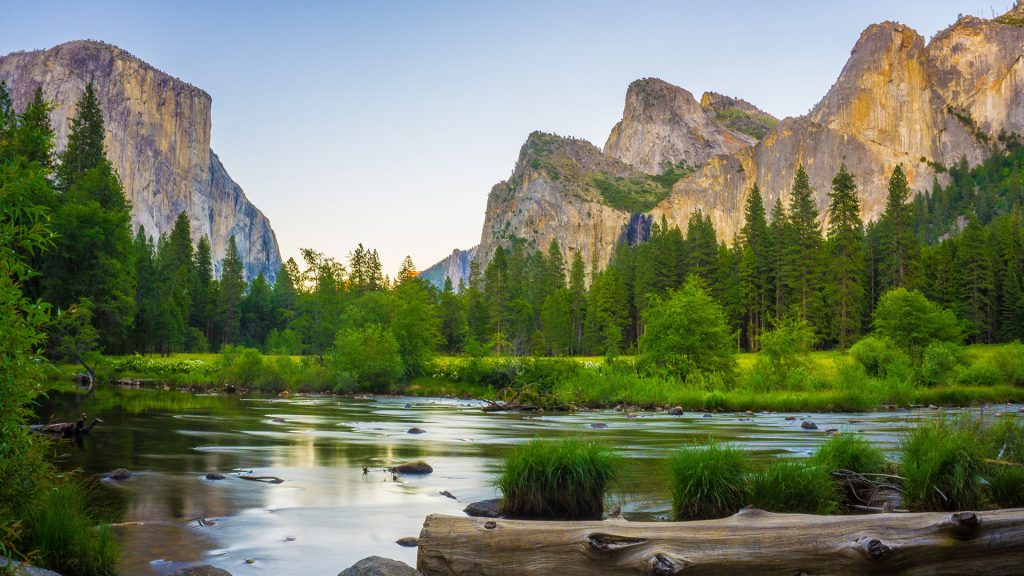 Yosemite National Park with El Capitan and Bridalveil Falls behind Merced River, California, USA