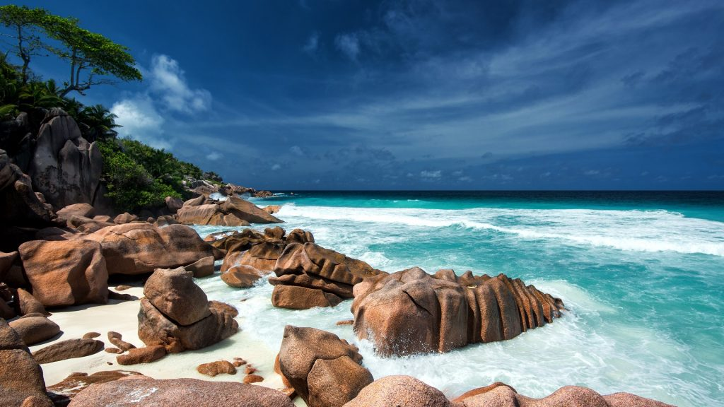 Waves and granite rocks on a paradise beach, La Digue, Seychelles Islands