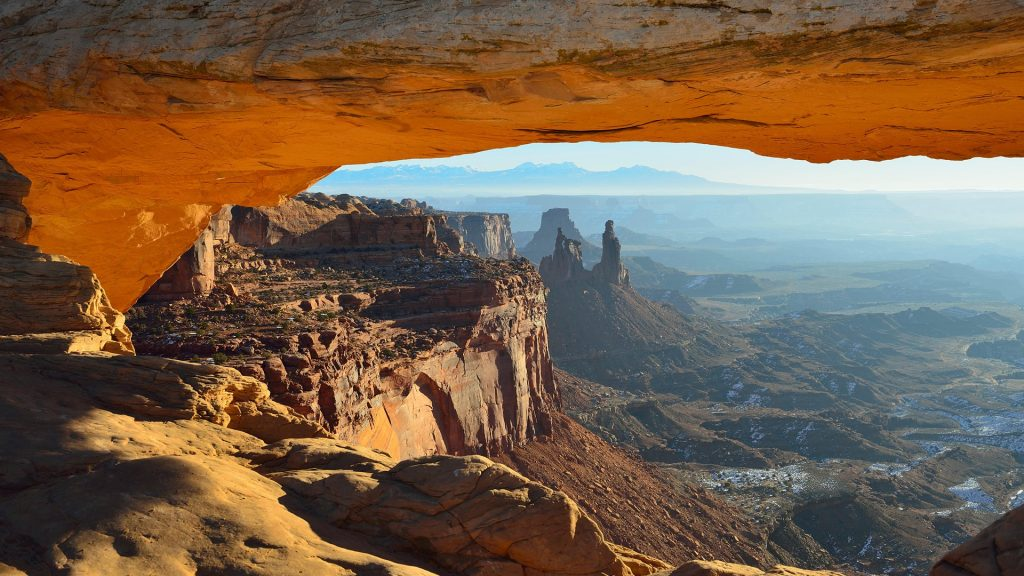 View through the Mesa Arch in Utah Canyonlands National Park in winter, USA