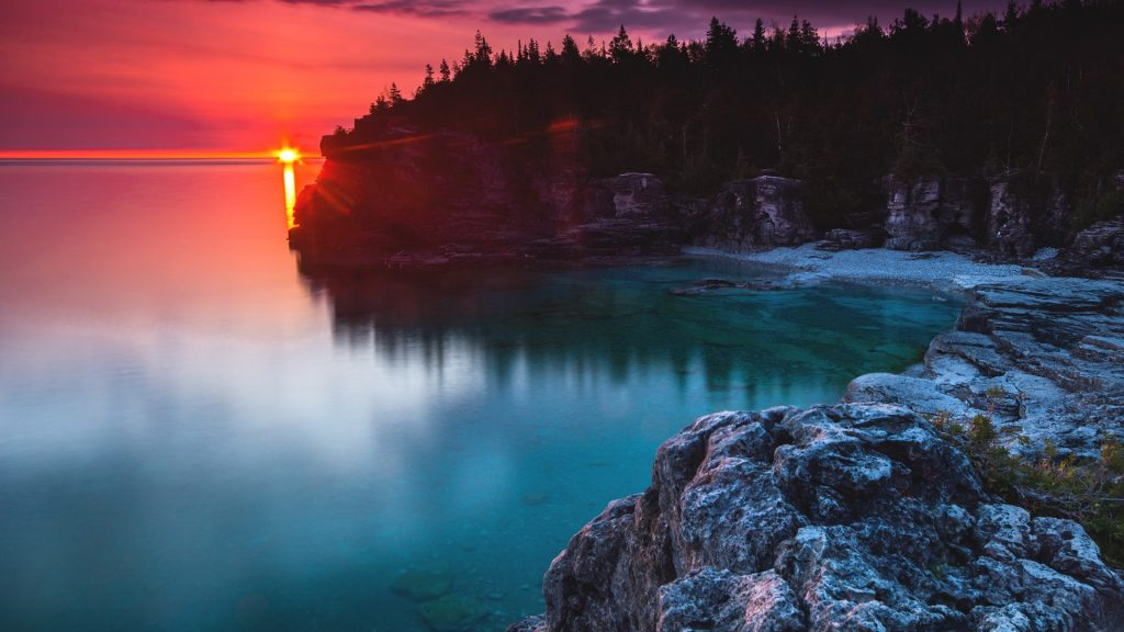 Indian Head Cove sunrise flare, Bruce Peninsula National Park, Ontario, Canada