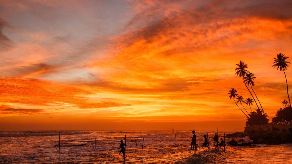 Sunset stilt fishing in Weligama Bay, Sri Lanka
