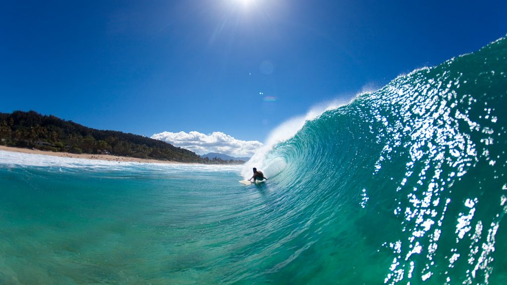 Water view of a surfer getting barreled at Pupukea Sandbar, Hawaii Islands, USA