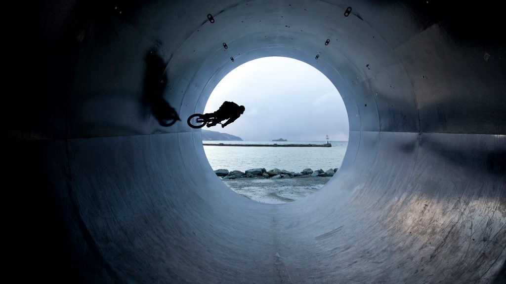 Man riding bmx bike in tunnel, Trondheim, Norway