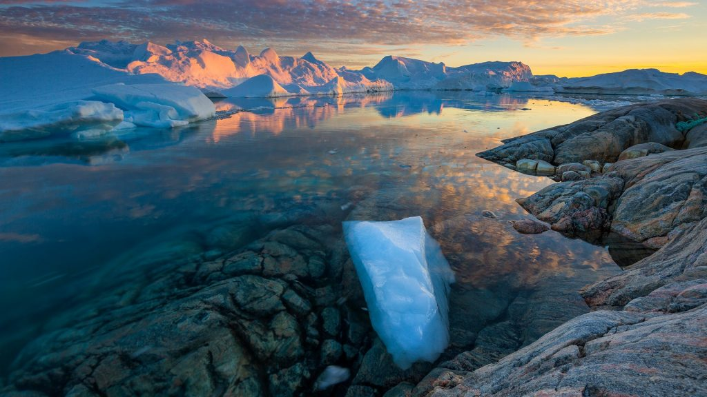 Clouds over Ilulissat Icefjord at scenic dusk, Greenland