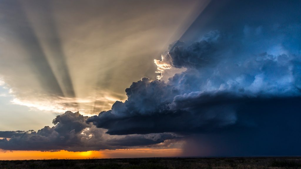 Extreme weather at sunset with rays of light over storm clouds, Carlsbad, New Mexico, USA