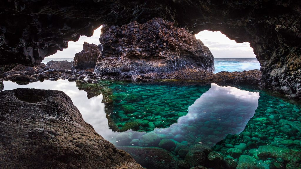 Natural pool in cave at Charco Azul near El Golfo, El Hierro Island, Canary Islands, Spain