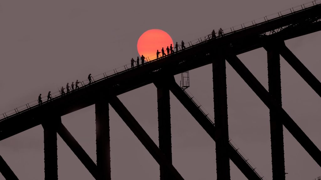 Harbour Bridge with climbers at sunset, Sydney, Australia